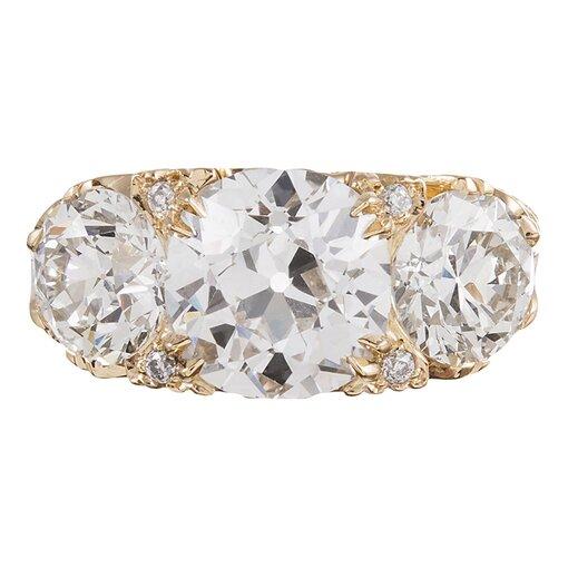 6.62 Carat English Carved Style Three-Stone Diamond Ring