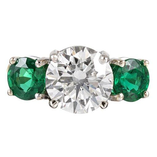 3.01 Carat Diamond and Emerald Three-Stone Ring