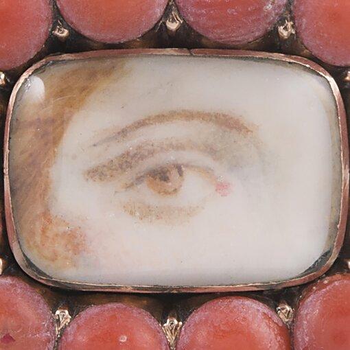 Coral-Framed Lover's Eye Pin